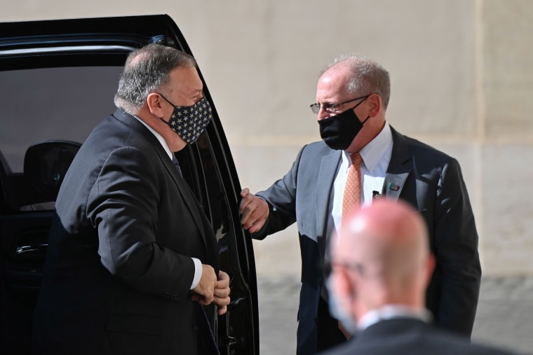 Image: Secretary of State Mike Pompeo gets out of his car as he arrives on Oct.1, 2020 at San Damaso courtyard in The Vatican