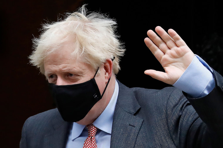 Image: Britain's Prime Minister Boris Johnson wears a face mask or covering due to the COVID-19 pandemic, as he leaves 10 Downing Street in central London