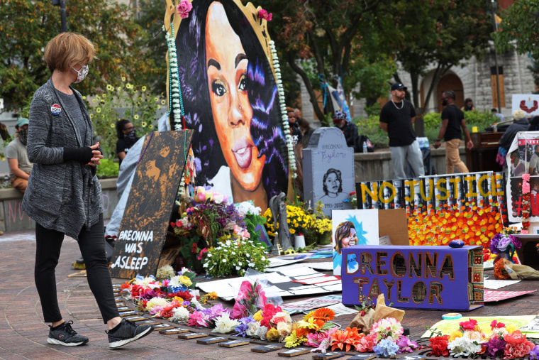 A woman looks at a memorial to Breonna Taylor in Jefferson Square Park on Sept. 26, 2020 in Louisville, Ky.