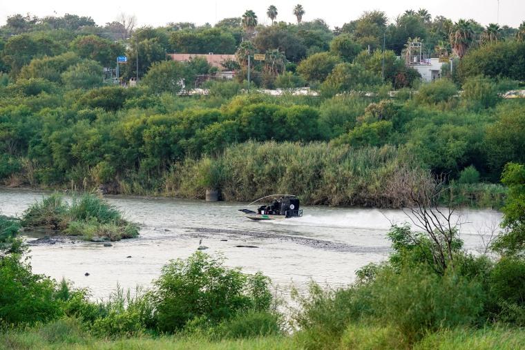 Image: Border Patrol agents patrol the Rio Grande in Laredo, Texas