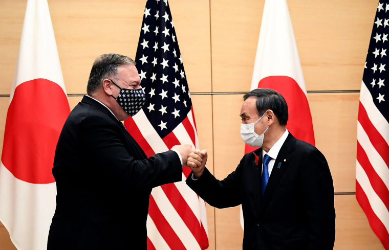 Image: Japan's Prime Minister Yoshihide Suga and Secretary of State Mike Pompeo (L) bump fists as they meet at the prime minister's office in Tokyo
