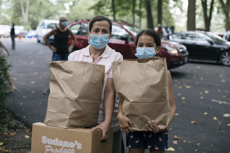 Seidy Meza Duran and her daughter, Seidy at a food pantry in Maryland during the COVID-19 pandemic.