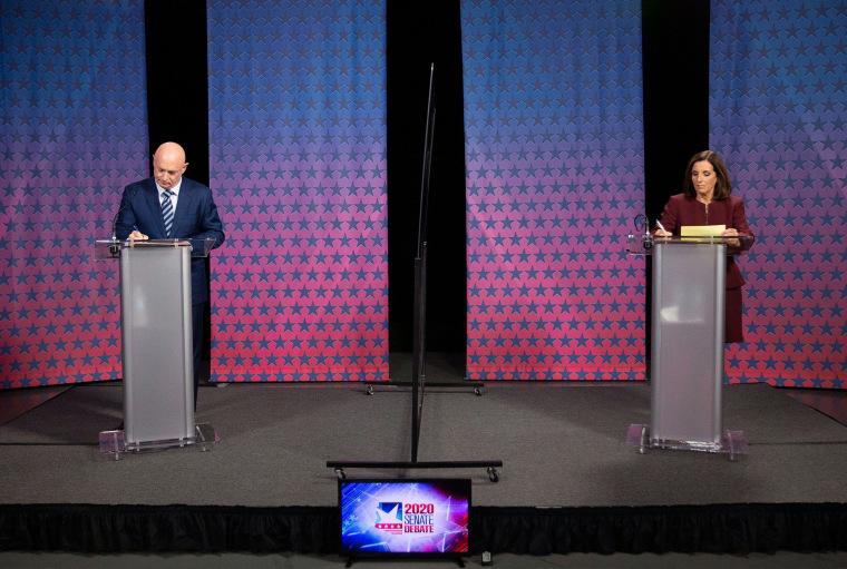 Image: Senator Martha McSally and Democratic challenger Mark Kelly prepare for their debate at the Walter Cronkite School of Journalism at Arizona State University in Phoenix