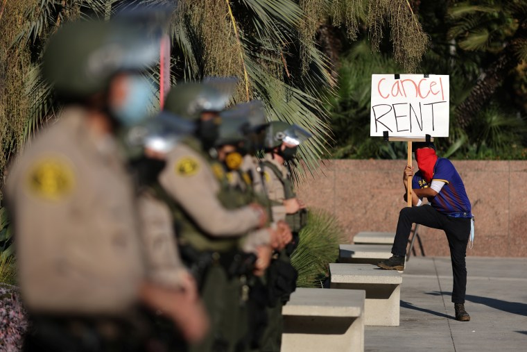 Image: Tenants and housing rights activists protest for a halting of rent payments and mortgage debt as sheriff's deputies block the entrance to the courthouse, during the coronavirus disease (COVID-19) outbreak, in Los Angeles