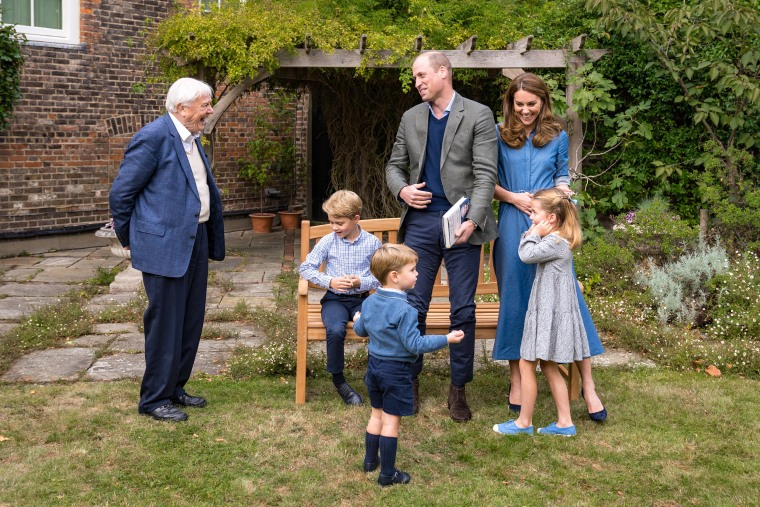 Britain's Prince William, Duke of Cambridge, Catherine, Duchess of Cambridge, Prince George (seated), Princess Charlotte and Prince Louis with Sir David Attenborough in the gardens of Kensington Palace in London after The Duke and Sir David attended an outdoor screening of Sir David's upcoming feature film, on Sept. 24, 2020.