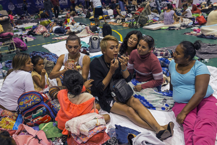 Image: Two transgender women who are part of a group of 50 or so LGBTQ migrants traveling with the migrant caravan hoping to reach the U.S. border, at a shelter in Cordoba, Mexico.