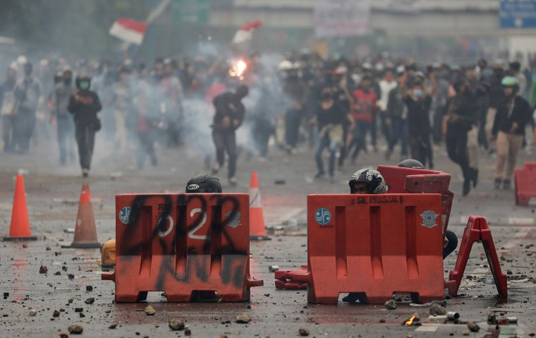 Image: Protesters demand for a polarising new labour law to be repealed in Jakarta, Indonesia