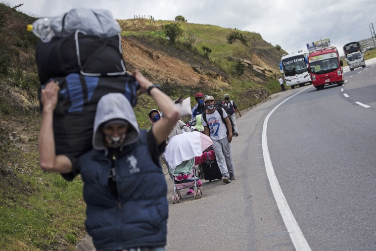 Venezuelan migrants walk to Bogota as they pass through Tunja, Colombia, on Oct. 6, 2020.