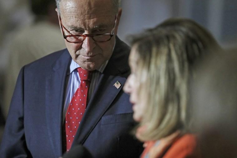Senate Minority Leader Chuck Schumer, D-N.Y., and House Speaker Nancy Pelosi, D-Calif., speak at the Capitol on Aug. 4.