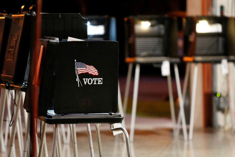 Image: FILE PHOTO: A voting booth is seen at a polling center inside a fire station in the Coral Gables neighbourhood during the Democratic presidential primary election in Miami