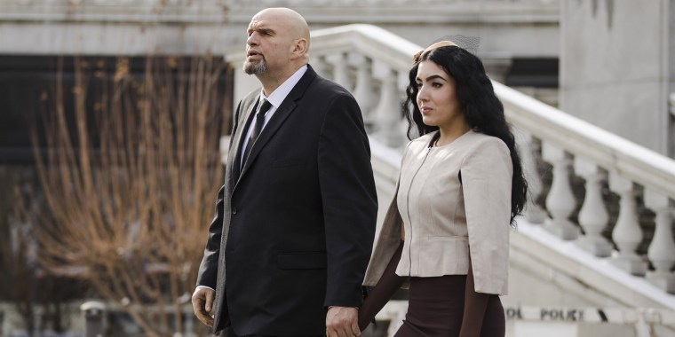 Pennsylvania Lieutenant Governor John Fetterman and his wife Gisele walk to Pennsylvania Gov. Tom Wolf's inauguration, Tuesday, Jan. 15, 2019, at the state Capitol in Harrisburg, Pa.
