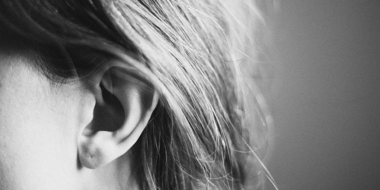 A woman's ear, listening