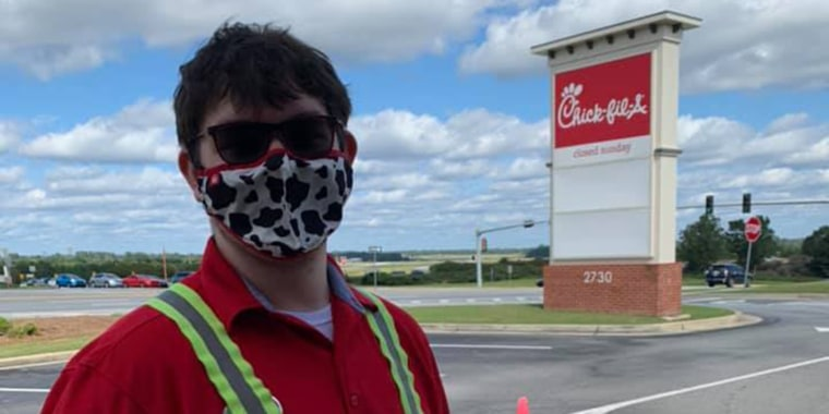 """Zack """"Cowboy"""" Kokenzie, Columbus High School graduate and Eagle Scout, happened to be working the drive-thru when he heard a child was choking and came to the rescue."""