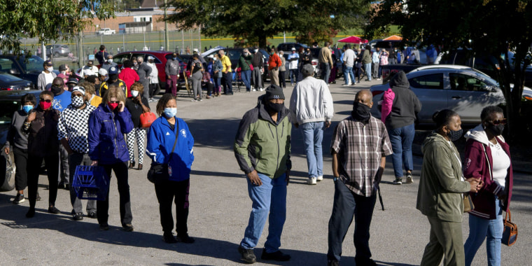 People wait in line to vote in Chattanooga, Tennessee, on Wednesday.