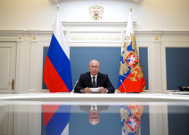 Image: Russian President Putin takes part in a video conference call in Moscow