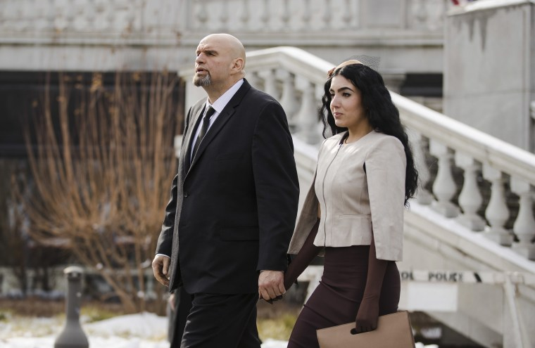 Image: Pennsylvania Lieutenant Governor John Fetterman and his wife Gisele walk to Pennsylvania Gov. Tom Wolf's inauguration,