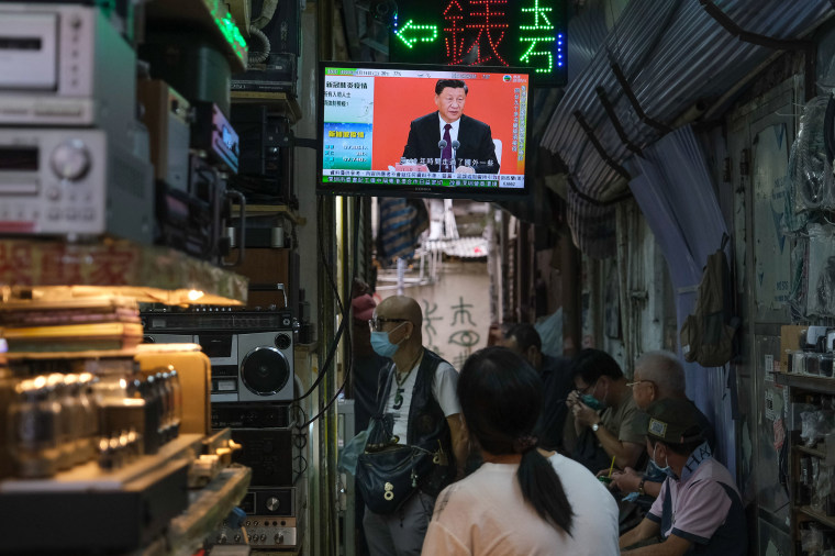 Image: A news report on Chinese President Xi Jinping's speech in the city of Shenzhen is shown on a television screen in Hong Kong, China