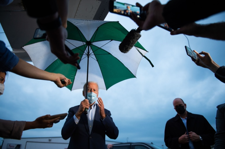 Image: Democratic presidential nominee Joe Biden speaks to the press at the Erie International Airport in Erie, Pa