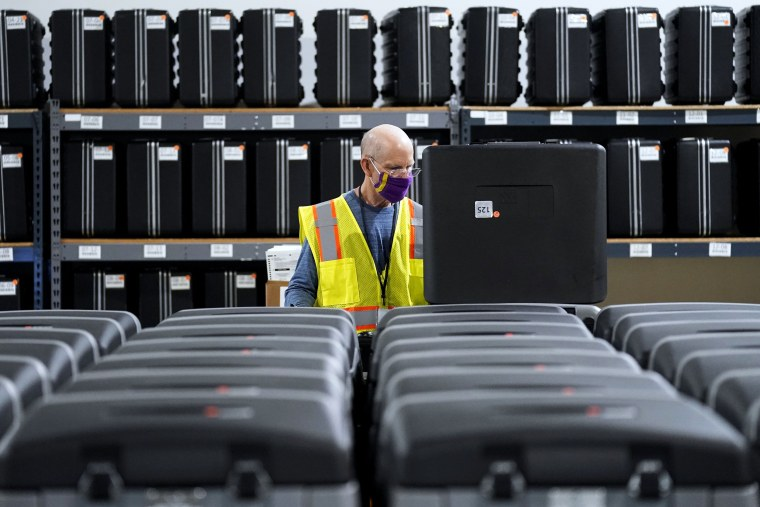 A worker prepares tabulators for the upcoming election at the Wake County Board of Elections in Raleigh, N.C., on Sept. 3, 2020.
