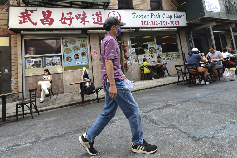 Patrons eat at outdoor tables in Manhattan's Chinatown on Aug. 11.