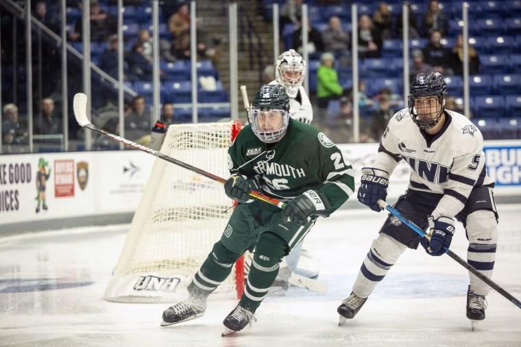 New Hampshire defenseman Will MacKinnon jockeys for position with Dartmouth forward Jeff Losurdo during game on Nov. 2, 2019.
