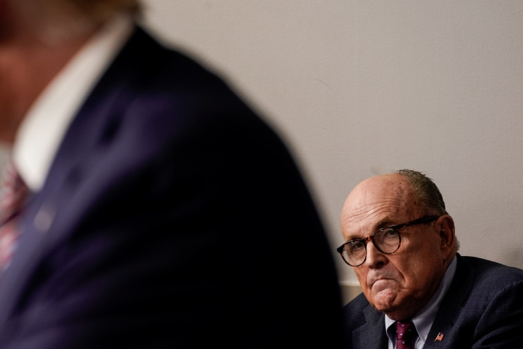 Image: Rudy Giuliani listens to U.S. President Trump speaks to reporters during a news conference