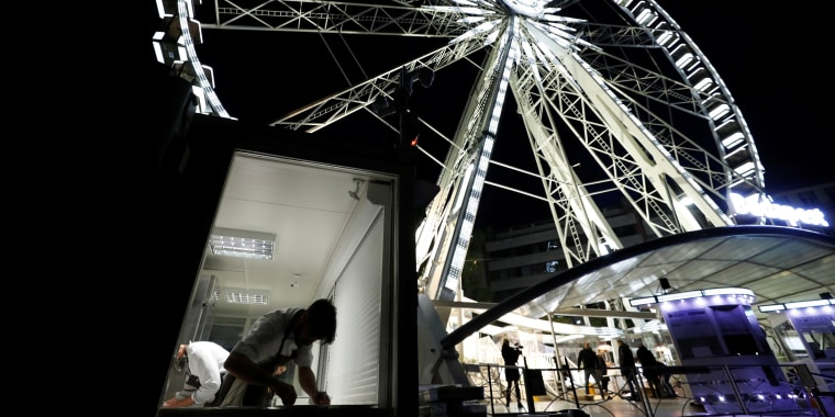 Image: A chef prepares food as Michelin-starred restaurant Costes moves into the Budapest Eye ferris wheel during the coronavirus outbreak