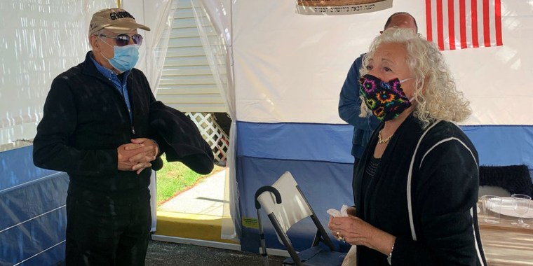 """Holocaust survivors Israel """"Sasha"""" Eisenberg, left, and Ruth Brandspiegel are reunited on Oct. 3, 2020, in East Brunswick, N.J. for the first time in more than 70 years since their families left the Hallein Displaced Persons Camp in Austria."""