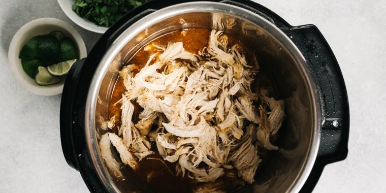 Shredded spiced chicken inside of an Instant Pot