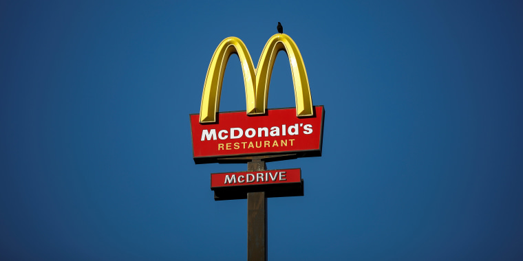 Image: The McDonald's company logo stands on a sign outside a restaurant in Bretigny-sur-Orge, near Paris