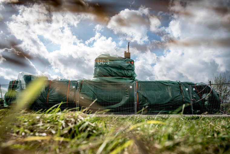 Image: The UC3 Nautilus homemade submarine covered with green tarpaulin in Nordhavn, a harbor area in Copenhagen, Denmark.