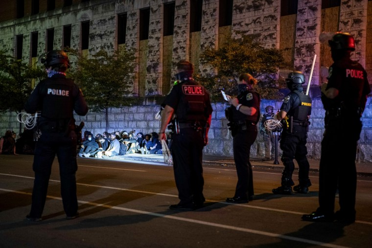 Image: Police officers detain protesters during demonstrations against the grand jury decision in the Breonna Taylor case in Louisville, Ky., on Sept. 23, 2020.
