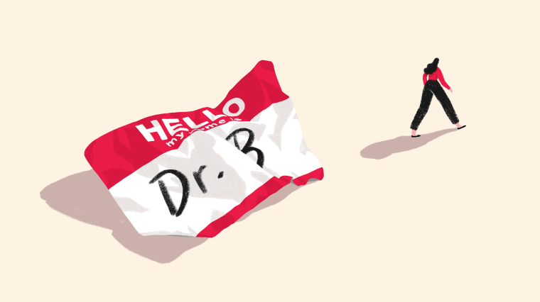 """Image: A crumpled """"Hello, my name is Dr. B"""" sticker as a woman walks away from it."""