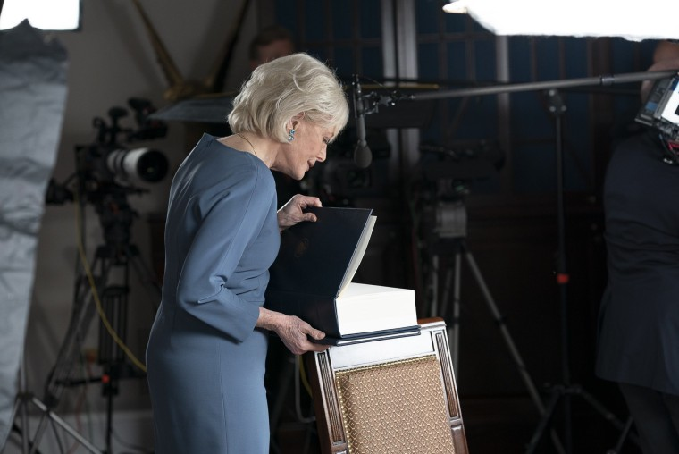 Lesley Stahl of CBS News opens a book given to her by White House Press Secretary Kayleigh McEnany purporting to contain Trump administration health policy initiatives, October 20, 2020.