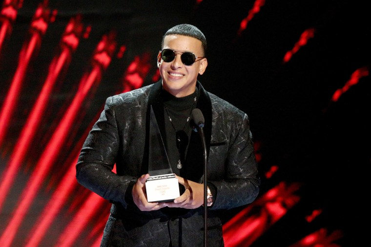 Image: Daddy Yankee accepts the Icon Award onstage during the 2018 Latin American Music Awards.