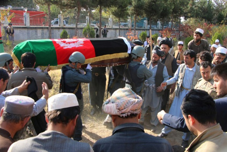 Image: People attend the funeral ceremony of senior police officer Raz Mohammad Dorandish in Taluqan, capital of Takhar province, Afghanistan