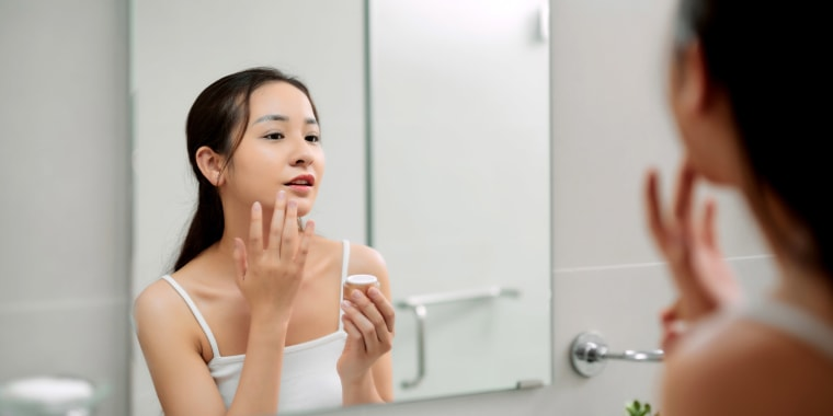 Woman caring for skin.