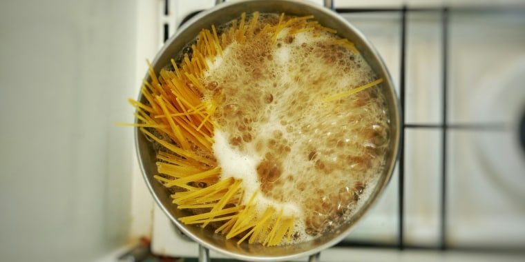 High Angle View Of Spaghetti In Boiling Water