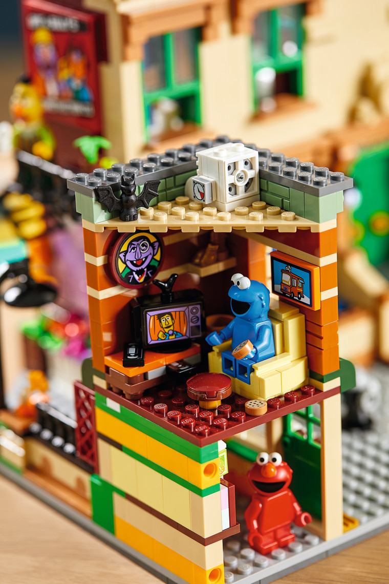 Cookie Monster watches Guy Smiley on TV in the first-ever LEGO Sesame Street set, in stores and online November 1.