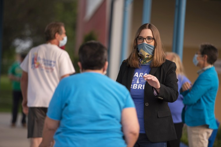 Transgender activist Sarah McBride, who hopes to win a seat in the Delaware Senate, campaigns at Maple Lane Elementary in Claymont, Del., on Sept. 15, 2020.