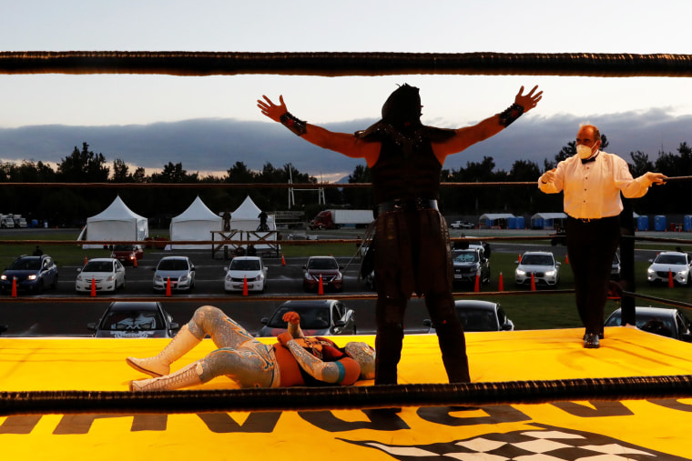Image: Mexico's iconic Lucha Libre wrestlers take part in a drive-in wrestling event amid the coronavirus pandemic
