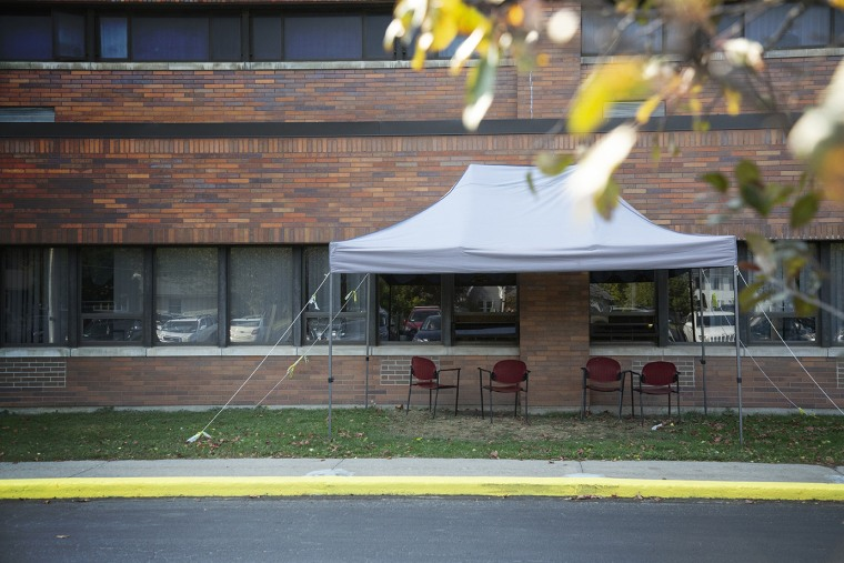 A tent is set up near the windows where visitors can see residents at the Premier Genesee Center for Nursing and Rehabilitation in Batavia, N.Y., on Oct. 9.