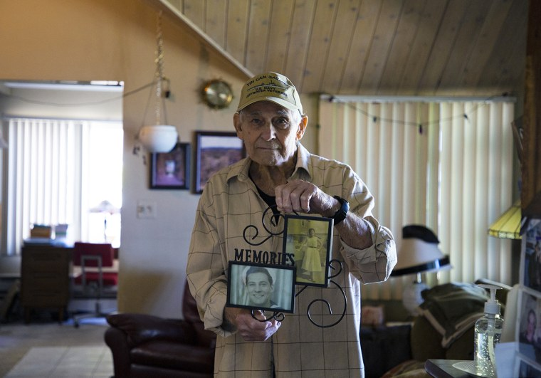 Vincent Randazzo holds a frame containing photos of him and his wife, Rose Violet Randazzo.