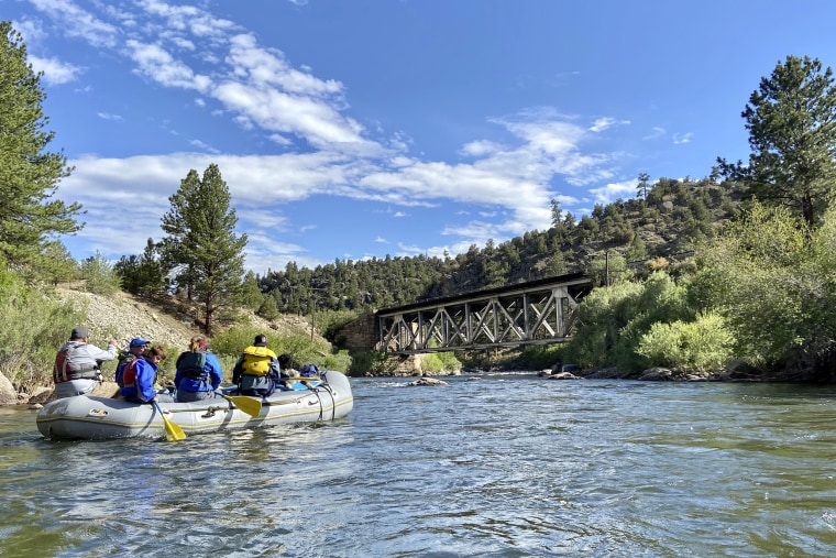 Rafters float down the Arkansas River on July 4, 2020, near Salida, Colo.