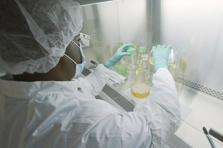 Image: A researcher tests possible COVID-19 antibodies in a laboratory in Indianapolis.
