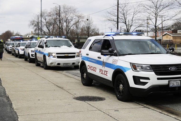 Chicago police vehicles wait to receive personal protective equipment on April 15, 2020.