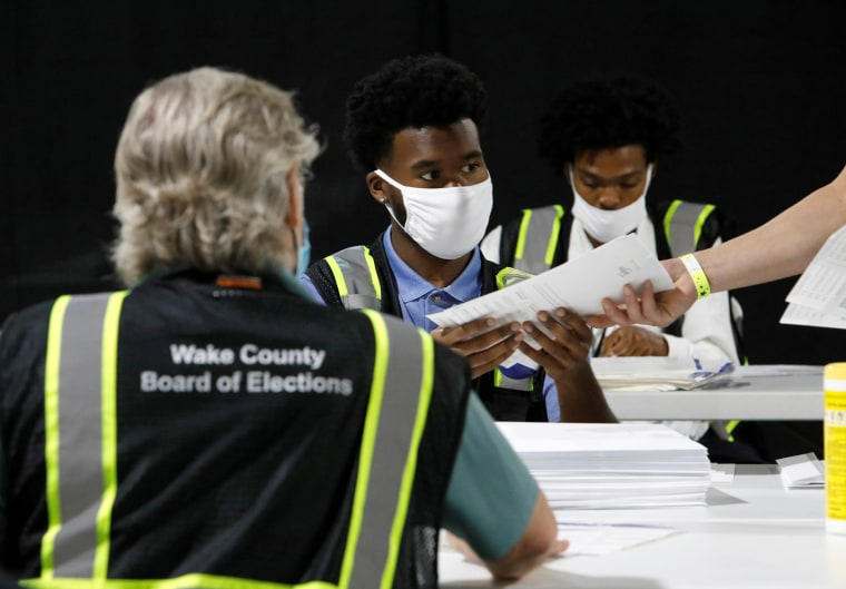 Image: Poll workers prepare absentee ballots for the general election in Raleigh