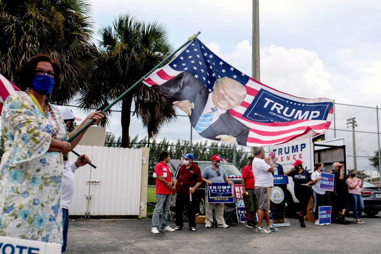 Image: Supporters for Donald Trump outside a polling station as early voting begins in Florida