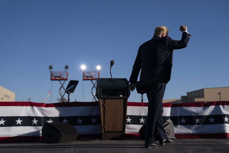 Image: President Donald Trump walks off stage after speaking during a campaign rally at Phoenix Goodyear Airport