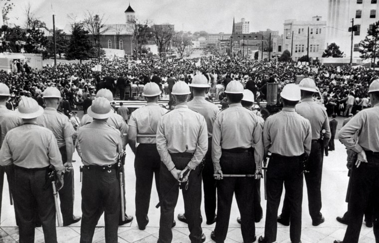 Image: State conservation agents, wielding nightsticks, watch as civil rights marchers arrive at the Alabama State Capitol in Montgomery, Ala., in 1965.